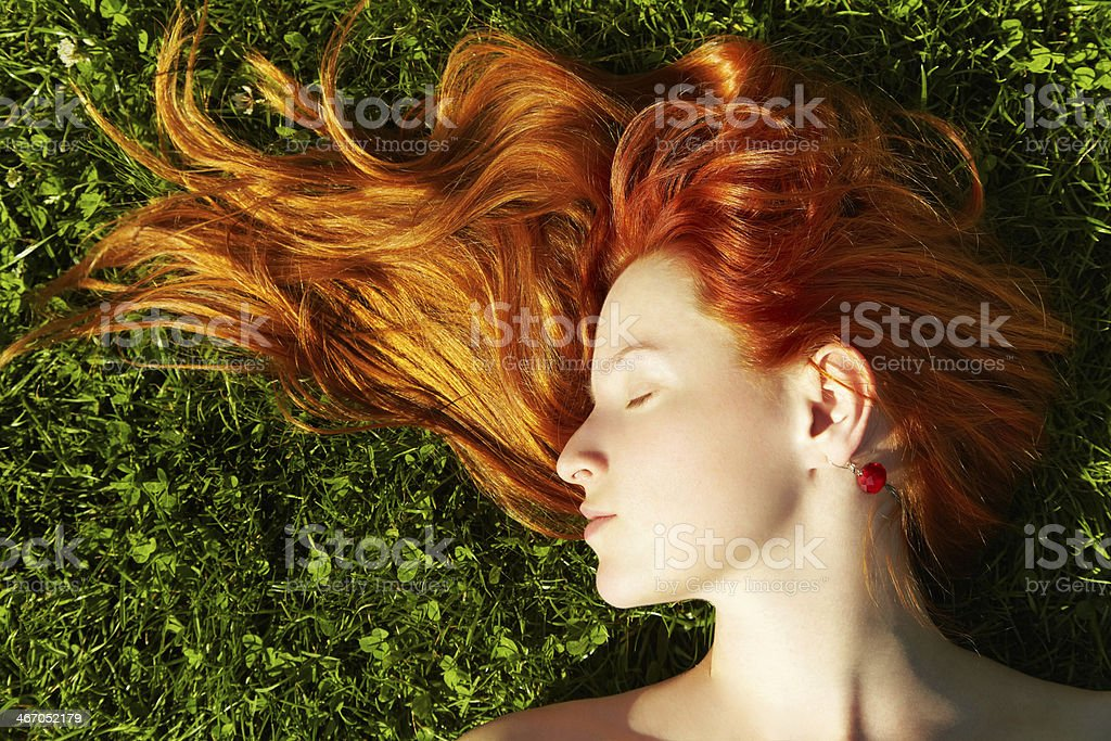 redhead girl stock photo
