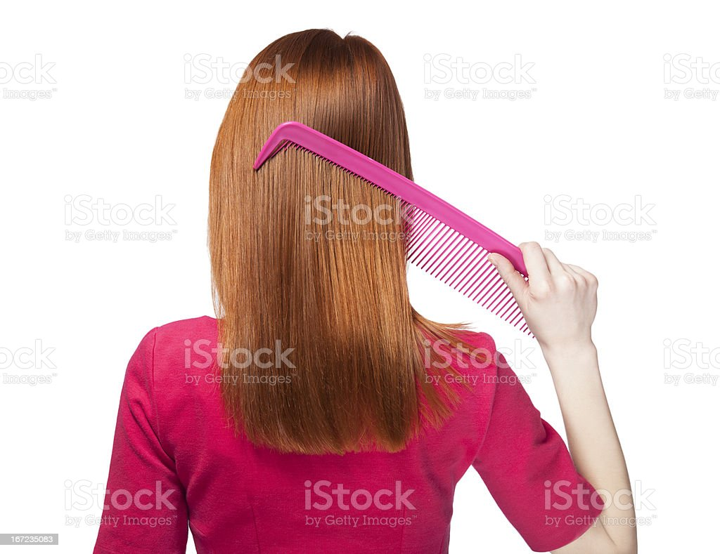 Redhead girl with big comb royalty-free stock photo