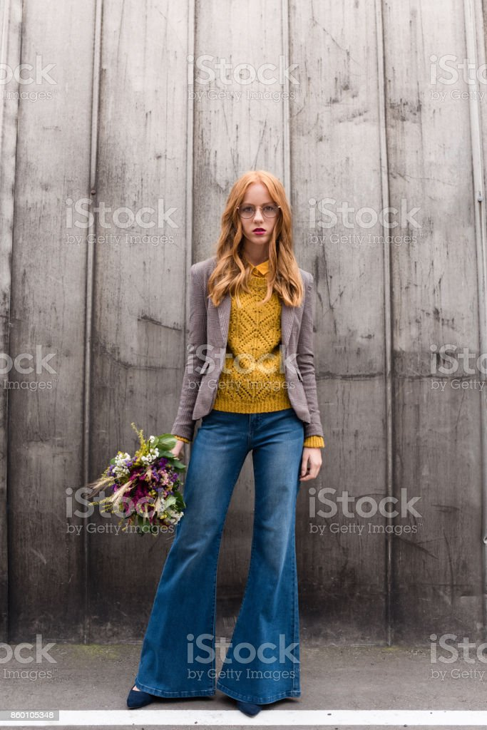 redhead girl with bouquet of flowers stock photo