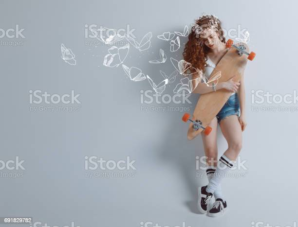 Redhead girl with butterflies and longbard picture id691829782?b=1&k=6&m=691829782&s=612x612&h=cobkitwvhza0mk5yzr6j9qffadph5ttnnayaalt6qbs=