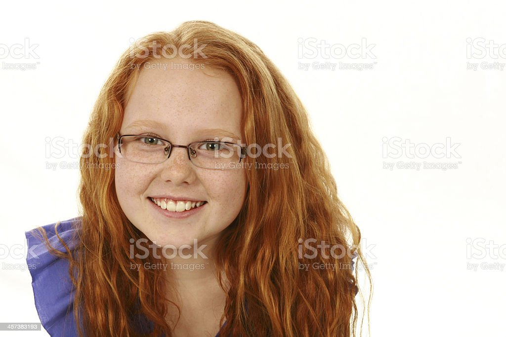 redhead girl with freckles and glasses stock photo