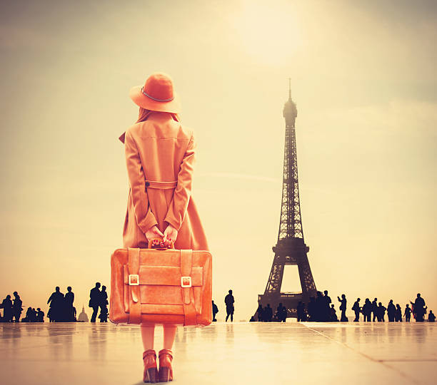 redhead girl with suitcase - paris fashion stock photos and pictures
