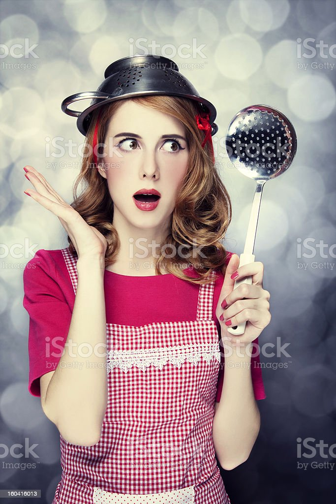 Redhead housewife with soup ladle royalty-free stock photo