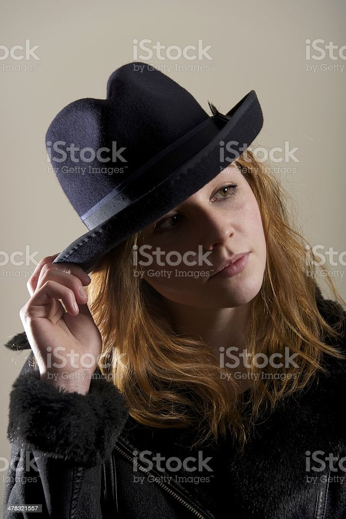 Redhead in black hat with head tilted royalty-free stock photo