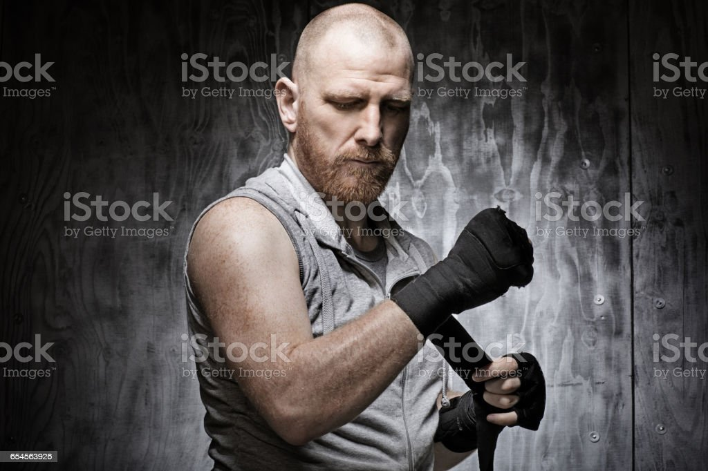 Redhead Middle Aged Man in Boxing Stance stock photo