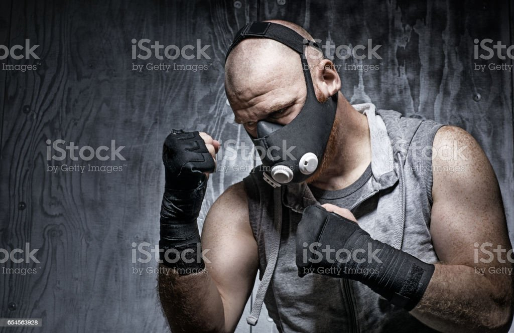 Redhead Middle Aged Man in Boxing Stance wearing breathing apparatus stock photo