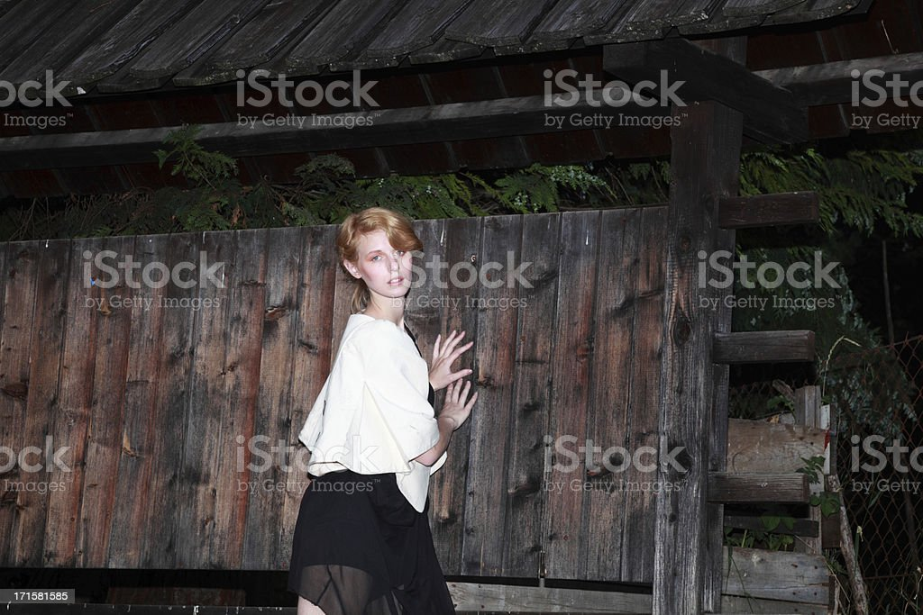 redhead model shows avant-garde fashion in stark lighting royalty-free stock photo
