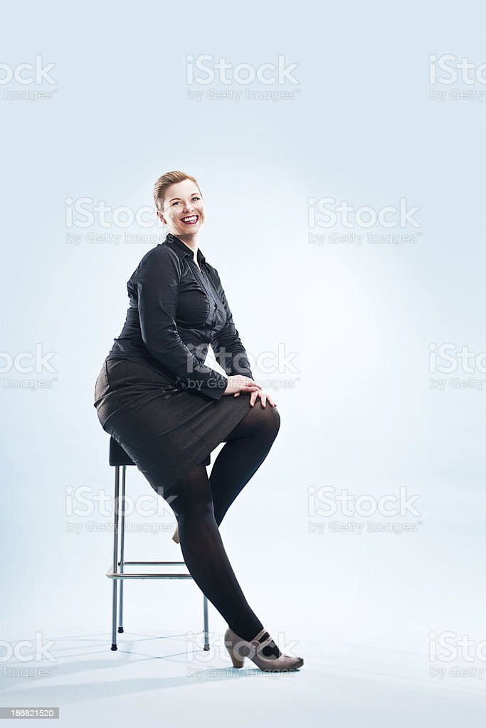 redhead on chair stock photo