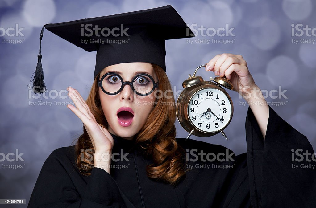 Redhead student with big clock royalty-free stock photo