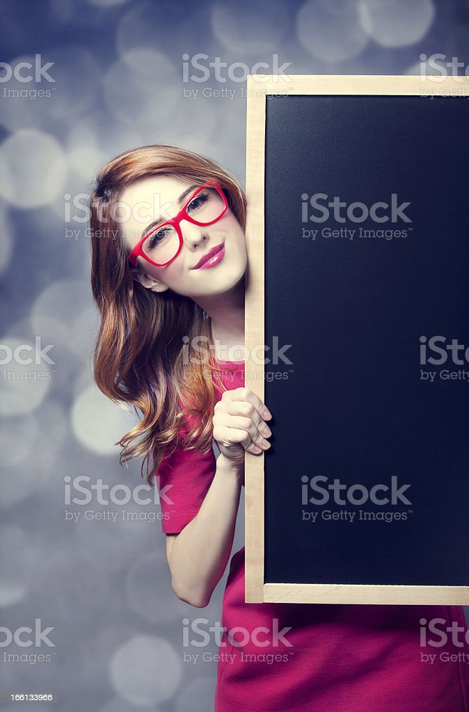 Redhead student with blackboard. royalty-free stock photo