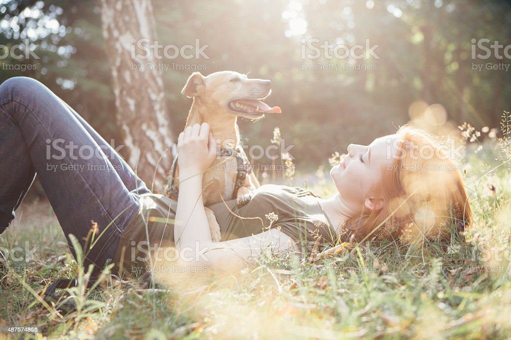 redhead teenage girl and her dog have fun outdoors royalty-free stock photo