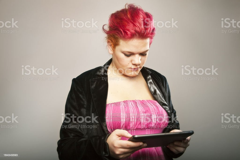 redhead with digital tablet royalty-free stock photo
