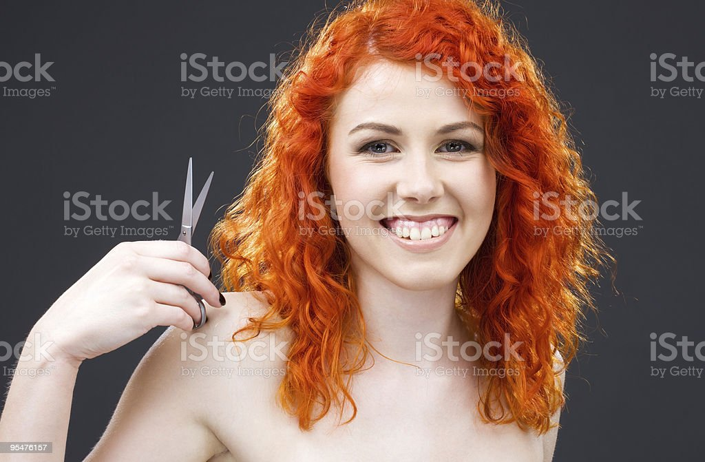 redhead with scissors royalty-free stock photo