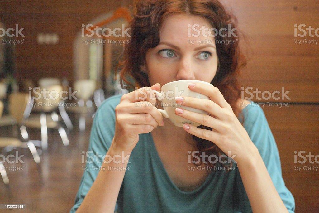 Redhead Woman Drinking Coffee royalty-free stock photo