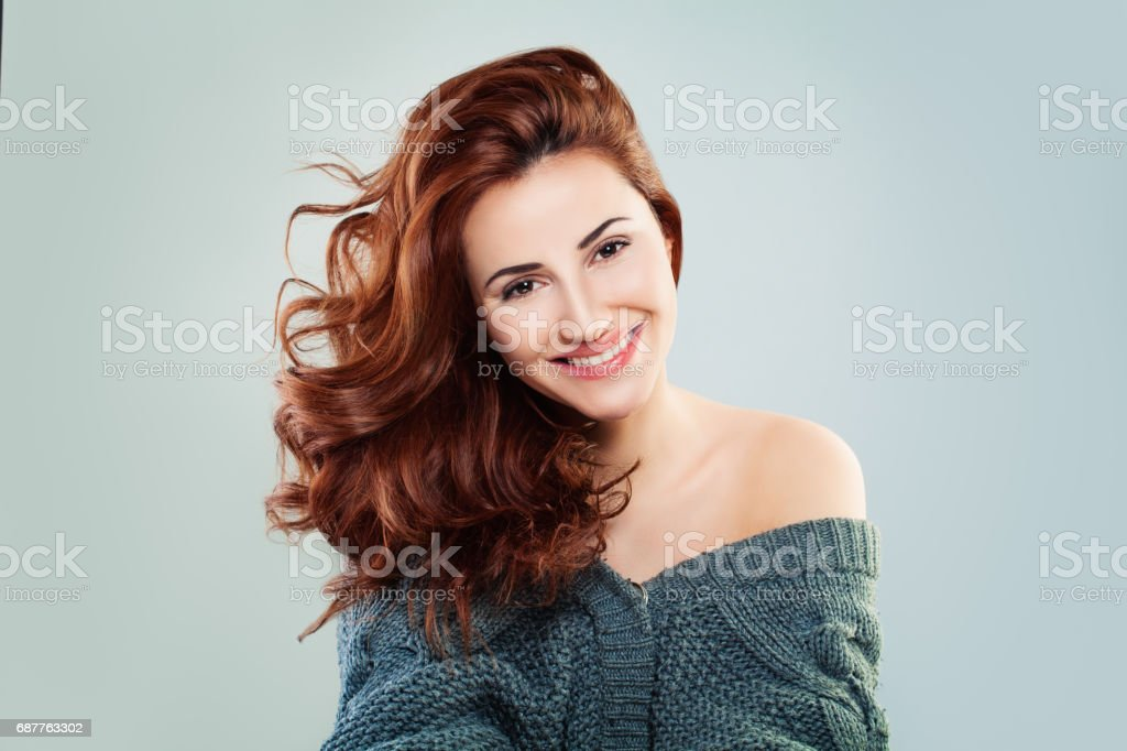Redhead Woman Fashion Model Smiling. Pretty Girl on Grey Background stock photo