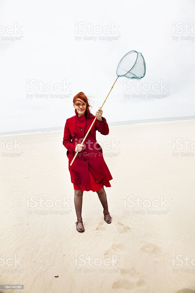 redhead woman going for a catch stock photo