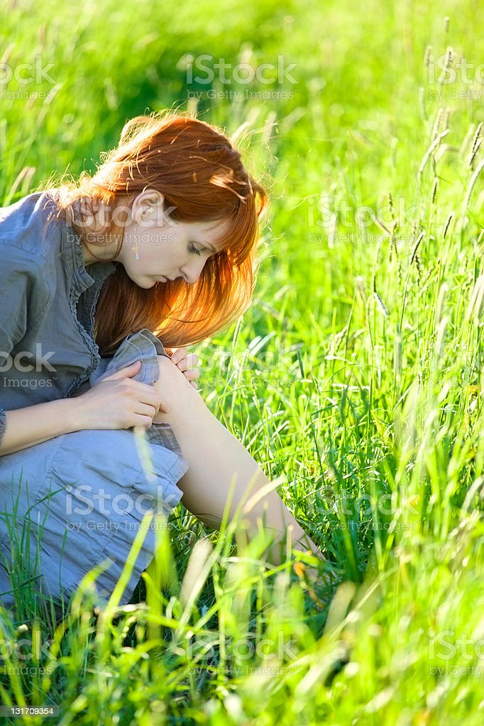 redhead woman looking wound stock photo