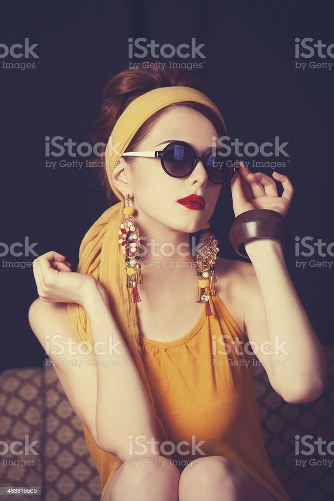 Redhead women sitting in the armchair. stock photo
