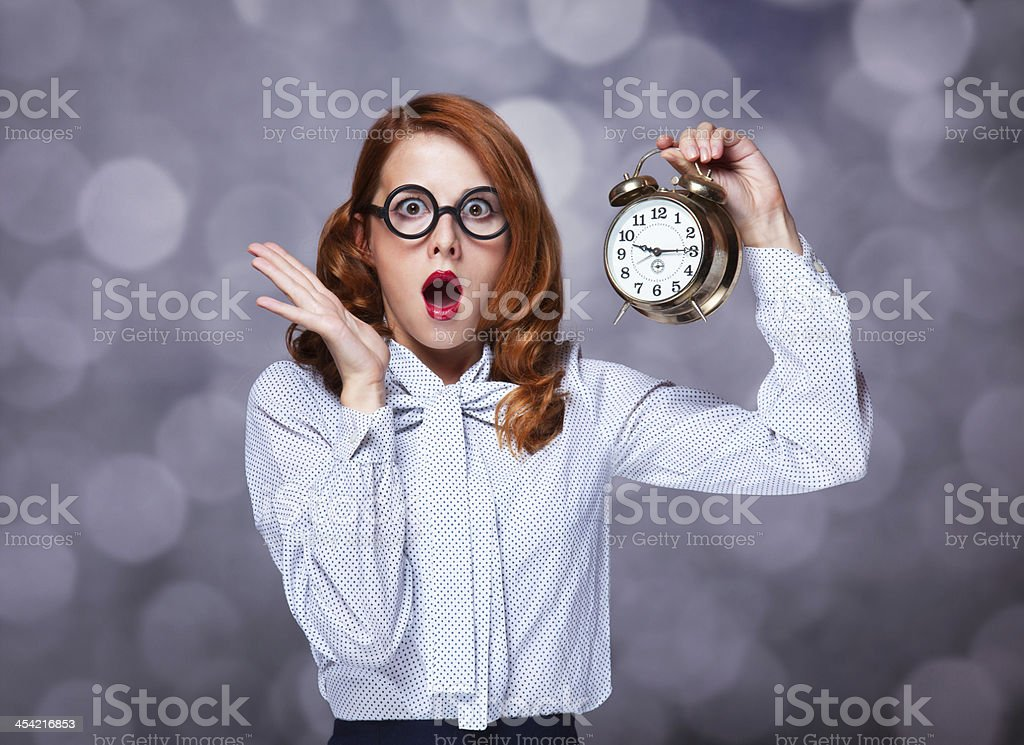 Redhead women with clock. stock photo