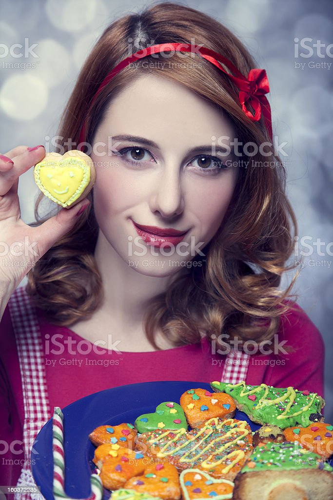 Redhead women with cookies royalty-free stock photo