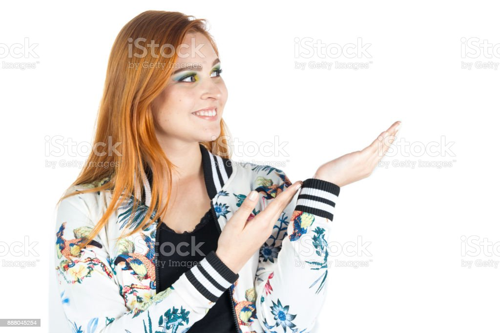 Redheaded pointing to caption space. stock photo