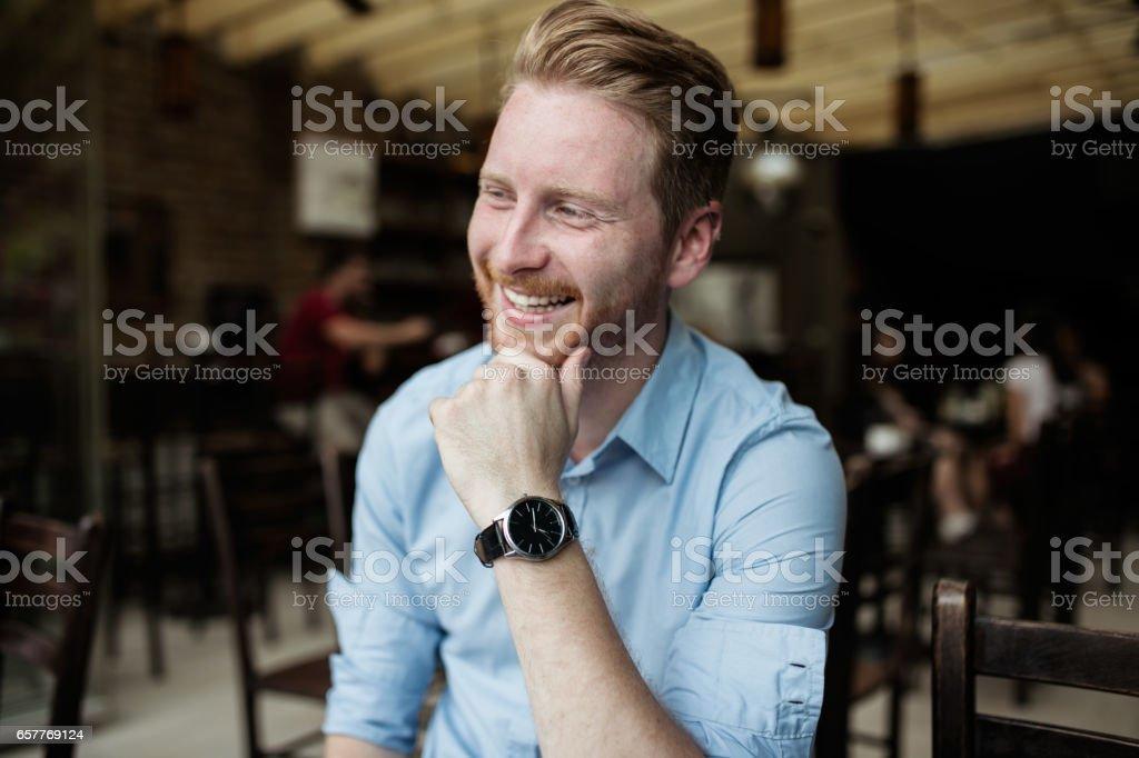 Redheaded Web Developer smiling stock photo