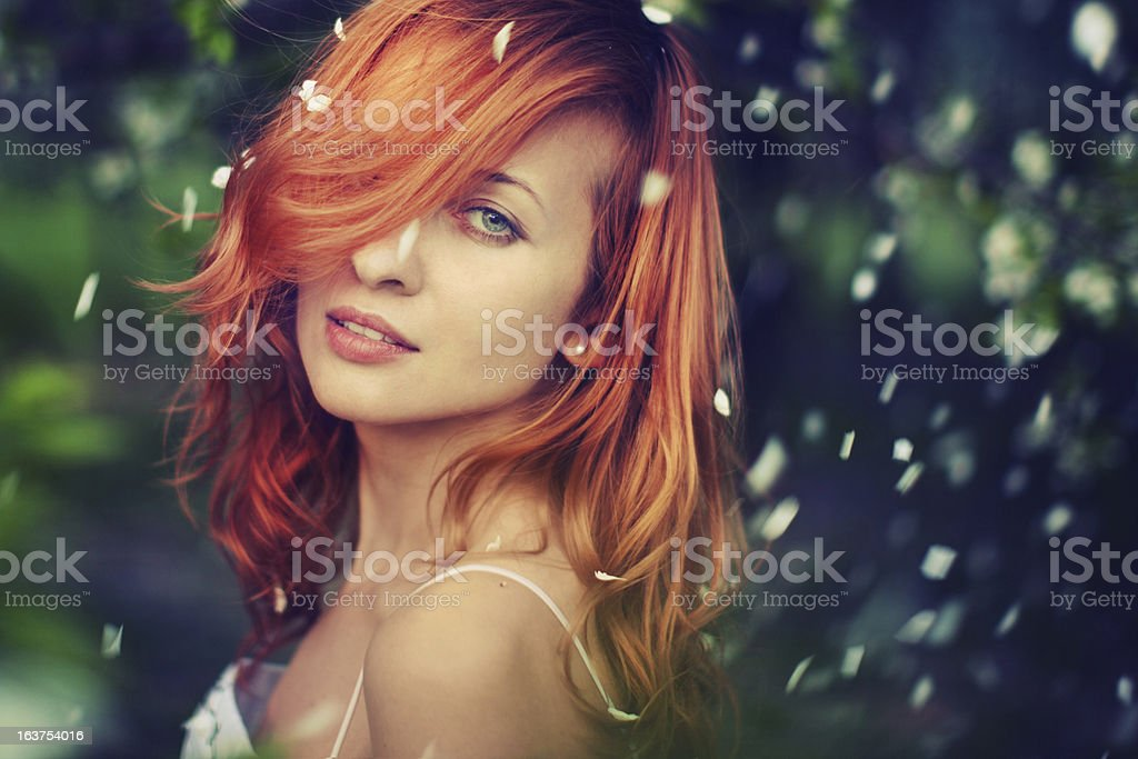 Redheaded Woman in Park stock photo