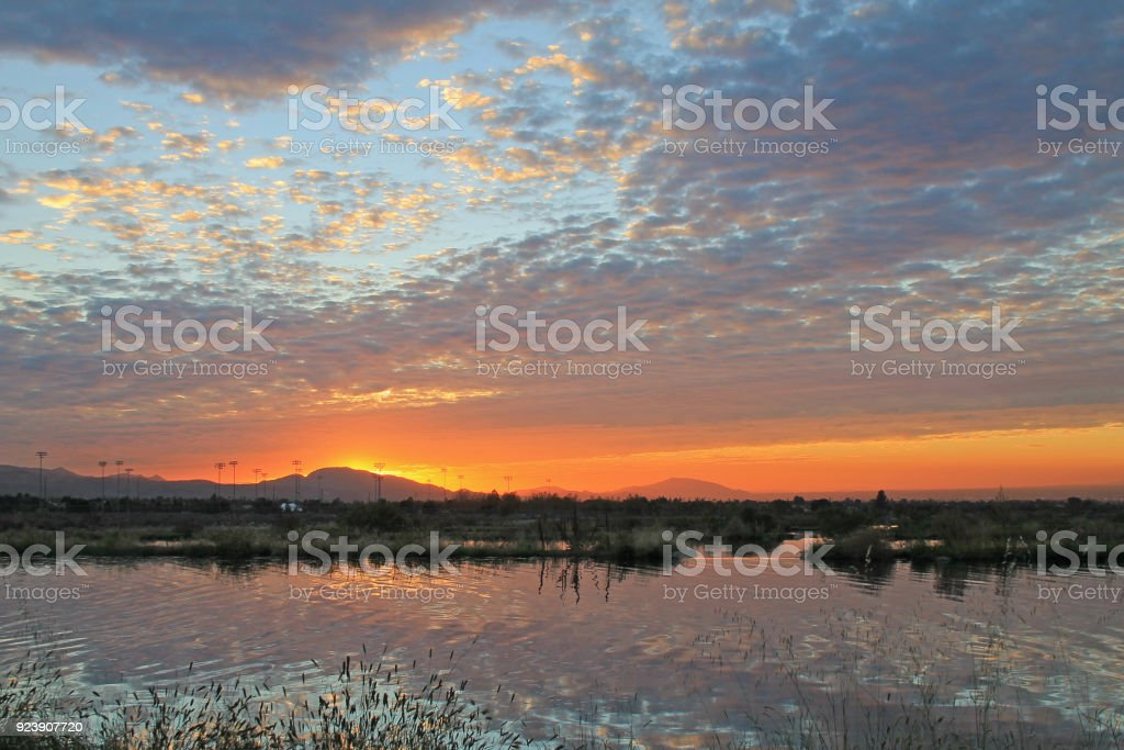 Redlands Reflection Sunsert Sunset reflection on water during a sunset in Redlands California California Stock Photo