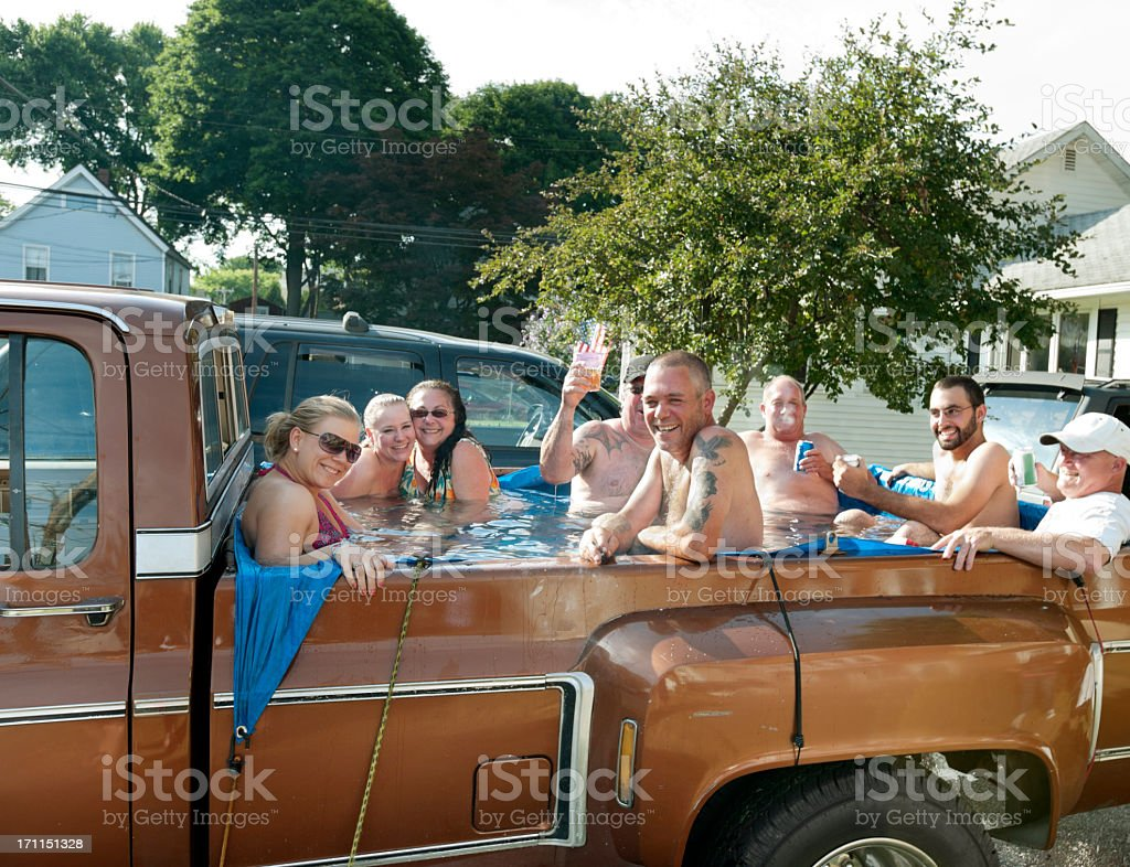 Redneck Jacuzzi, 8 people partying in back of pick-up truck stock photo