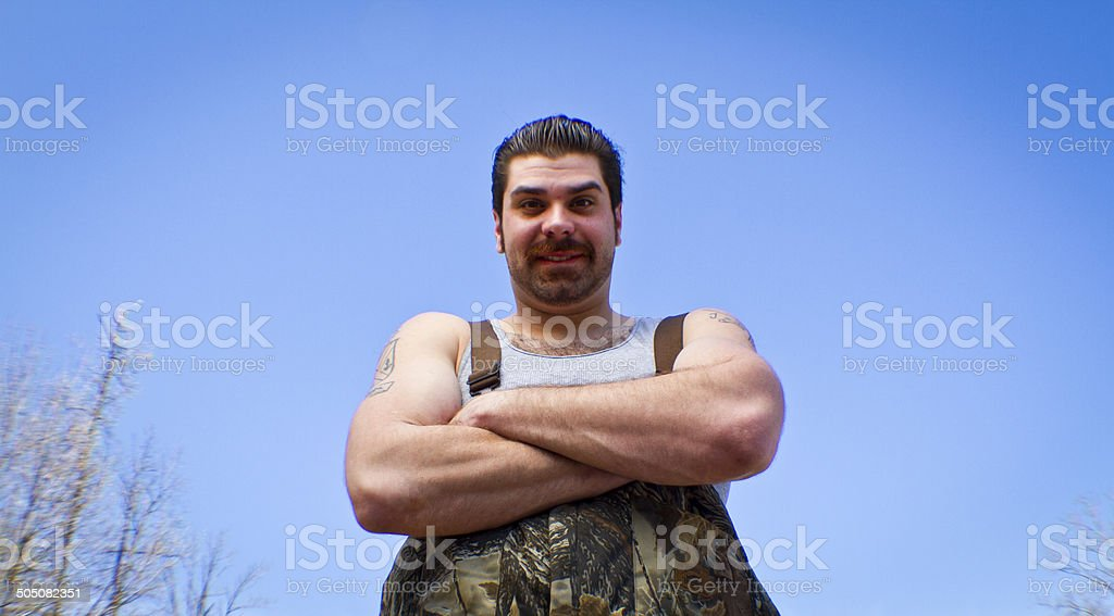 Redneck Mechanic Smiling at You stock photo