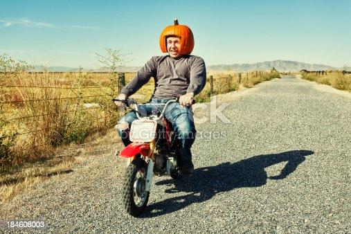 istock Redneck Pumpkin Motorcycle Racer 184608003