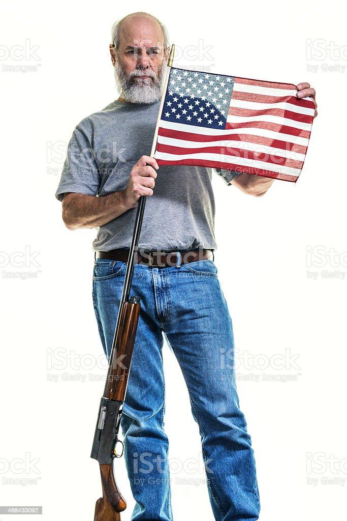 Redneck Senior Adult Man Holding Shotgun and American Flag stock photo