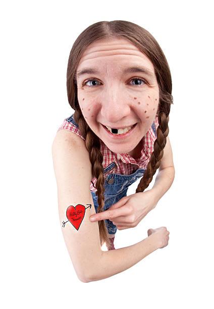 redneck frau zeigt ihre tattoo - monster stock-fotos und bilder