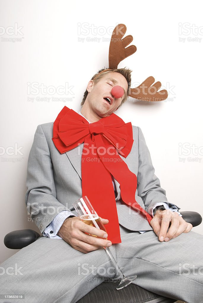 Red-Nosed Businessman Reindeer Passing Out Drunk at Office Party royalty-free stock photo