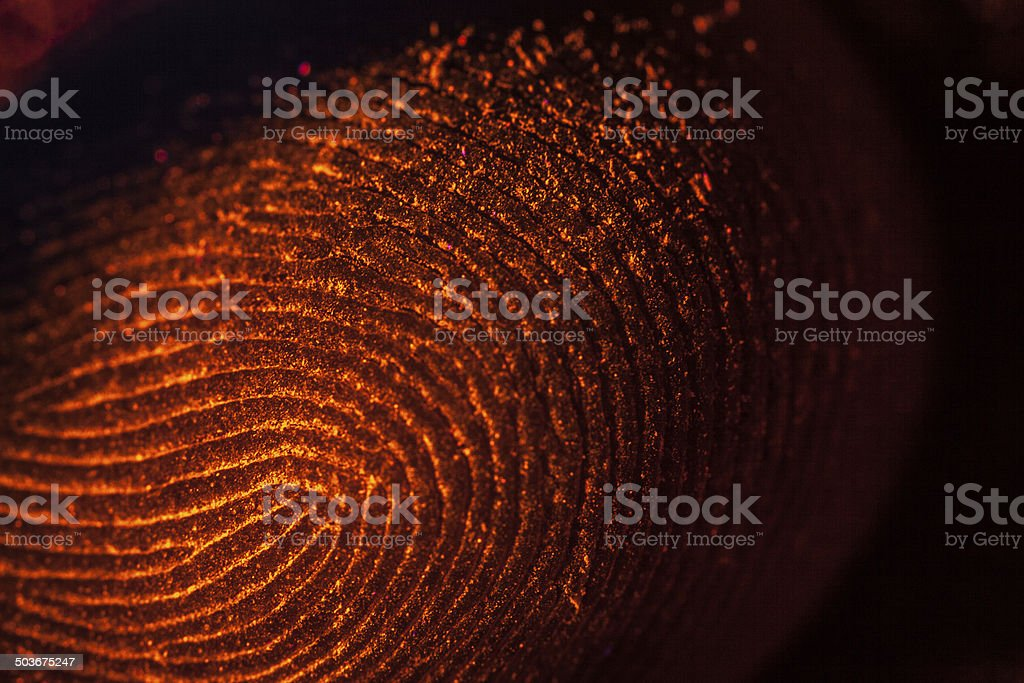 red-orange fingerprints on black stock photo