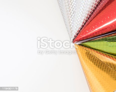 1135969446 istock photo Red,silver,green,gold, party hats for a celebration or a holidays with ribbons . 1194901178