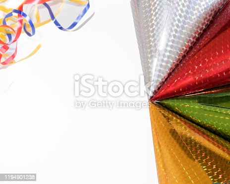 1135969446 istock photo Red,silver,green,gold, party hats for a celebration or a holidays with ribbons . 1194901238