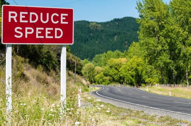 Reduce Speed warning sign stock photo