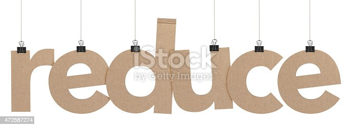 A  3D representation of the word reduce hanging on a plain white background. The word is hanging from binder paper clips that are attached to a piece of string. The letters have a cardboard texture. The background is pure white.