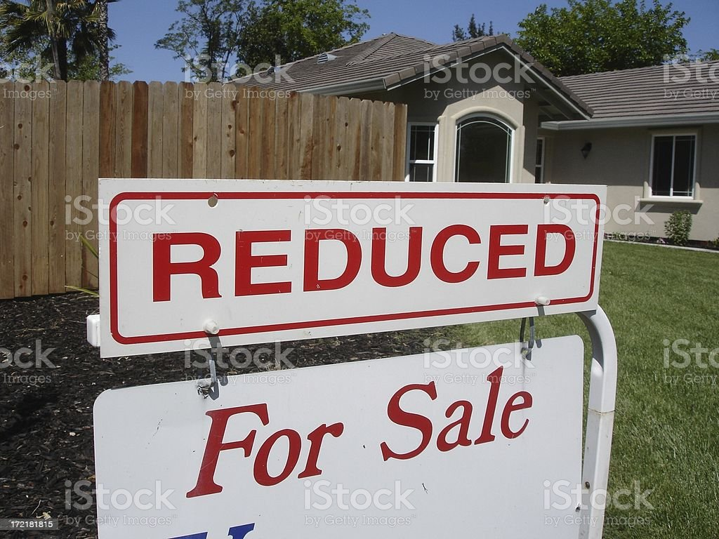 Reduced For sale real estate sign royalty-free stock photo