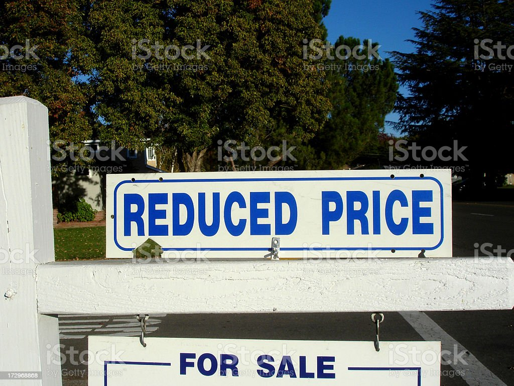 Reduced price real estate sign royalty-free stock photo