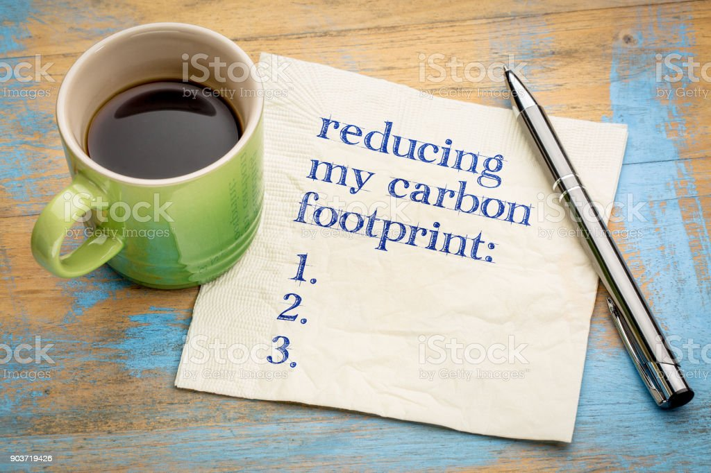 reducing my carbon footprint list stock photo