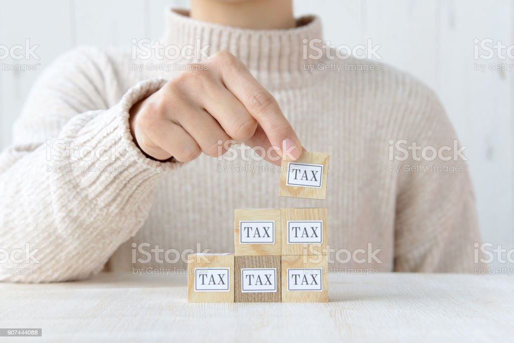 Reducing tax concepts stock photo