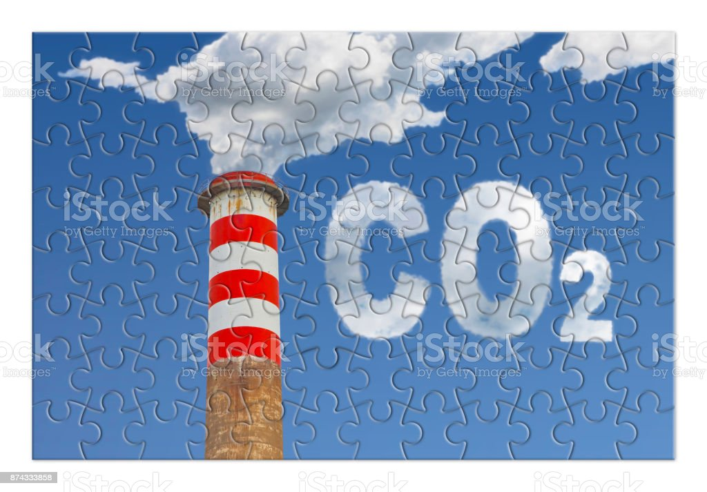 Reduction of CO2 presence in the atmosphere - jigsaw puzzle concept image stock photo
