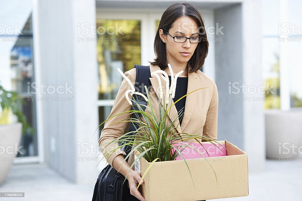 Redundant Businesswoman Leaving Office With Box stock photo