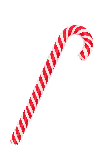 Red-white candy cane isolated on white Red-white candy cane isolated on white with shadow candy cane stock pictures, royalty-free photos & images