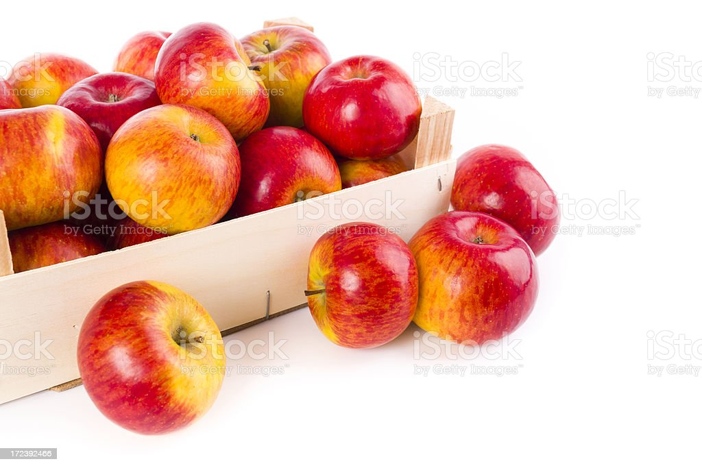 red-yellow apples in a small box royalty-free stock photo