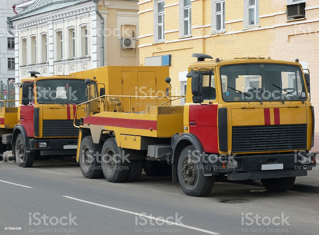 red-yellow emergency truck on asphalt road royaltyfri bildbanksbilder