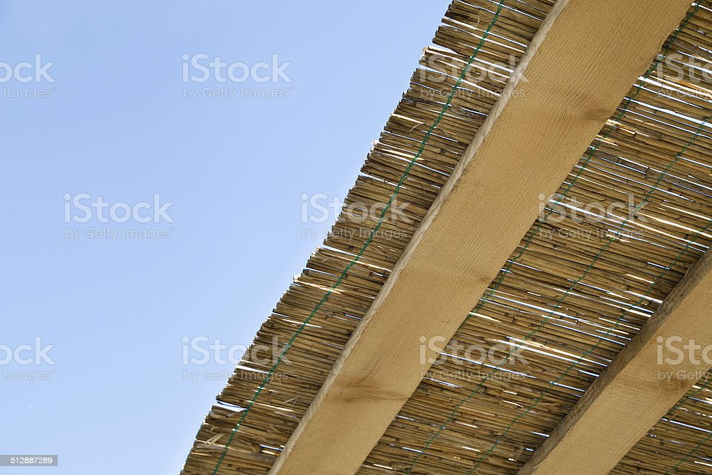 reed and wooden roof stock photo