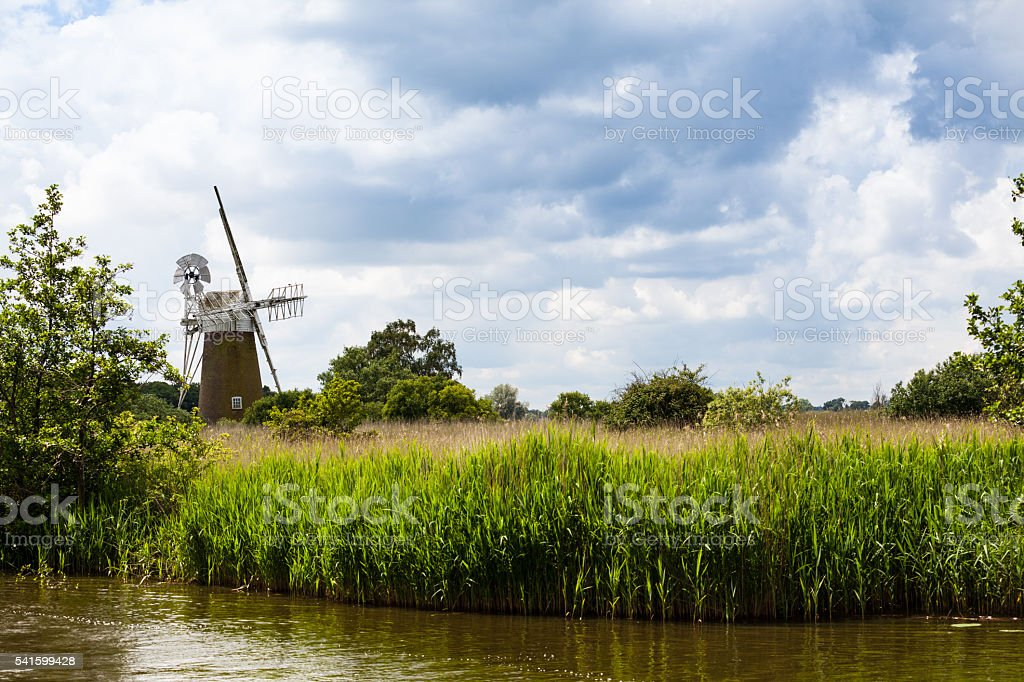 reeds and sedge beds windmill and river on Norfolk Broads stock photo